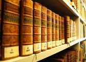 Old books in library — 图库照片
