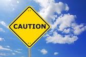 Yellow caution sign — Stock Photo