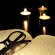 Royalty-Free Stock Photo: Book candle and glasses