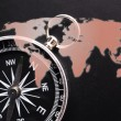 Compass and world map — Stock Photo
