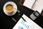 Coffee and financial data — Stock Photo