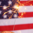 Sparkler and usa flag — Stock Photo #3876195