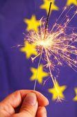 Euro union flag and sparkler — Stock Photo