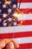 Sparkler and usa flag — Stock Photo