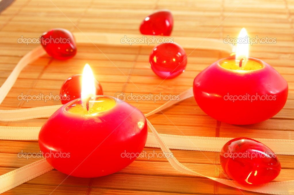 Romantic red xmas candles showing christmas decoration — Stock Photo #3874843