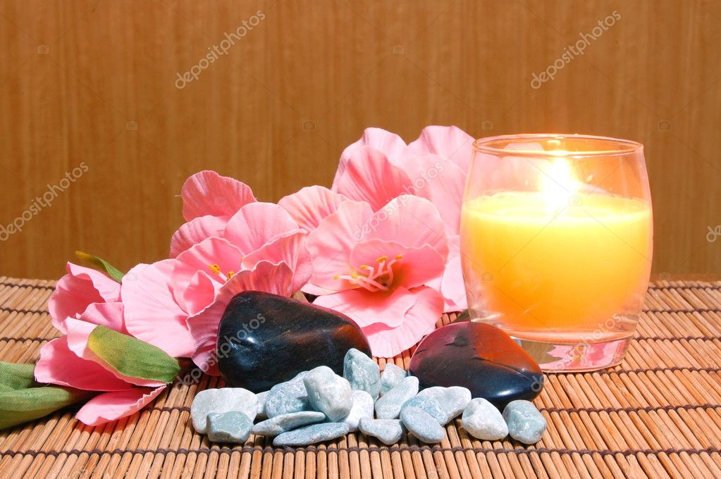 Spa and wellness concept with flowers zen stones and towel — Stock Photo #3874881