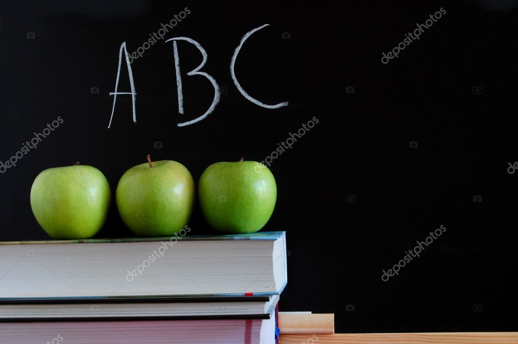Blackboard with apples and books showing a concept for education  Stock Photo #3875612