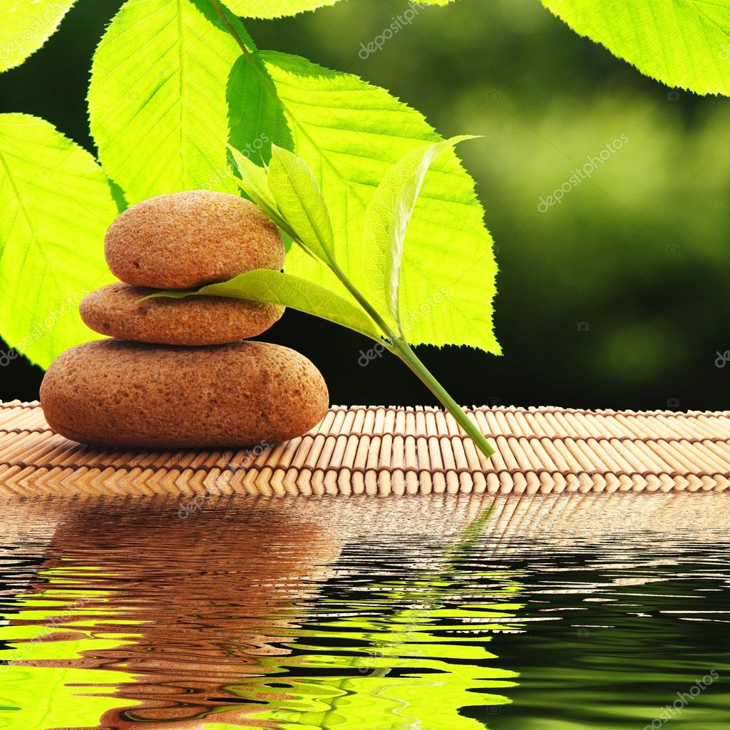 Zen stones and water reflection showing spa concept — Stock Photo #3923538