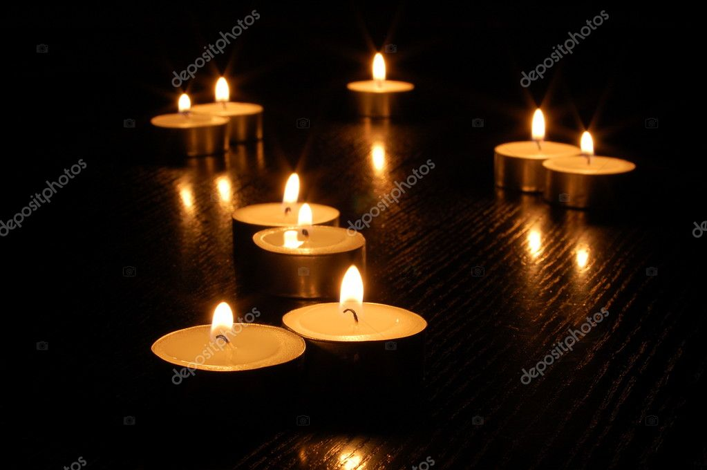 Romantic candle light on a black background — Stock Photo #3979452