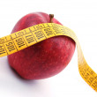 Apple and measuring tape on white — Stockfoto