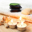 Foldet white bath towel and zen stones — Stock Photo