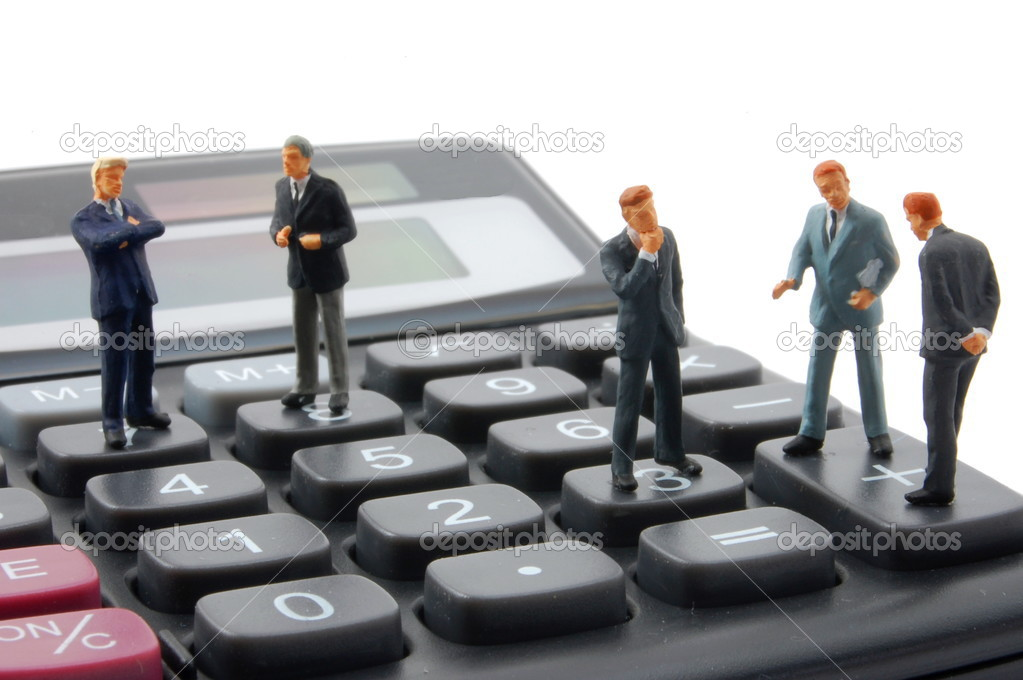 Toy business man on calculator isolated on white background — Stock Photo #4108927