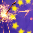 Euro union flag and sparkler - Stock Photo