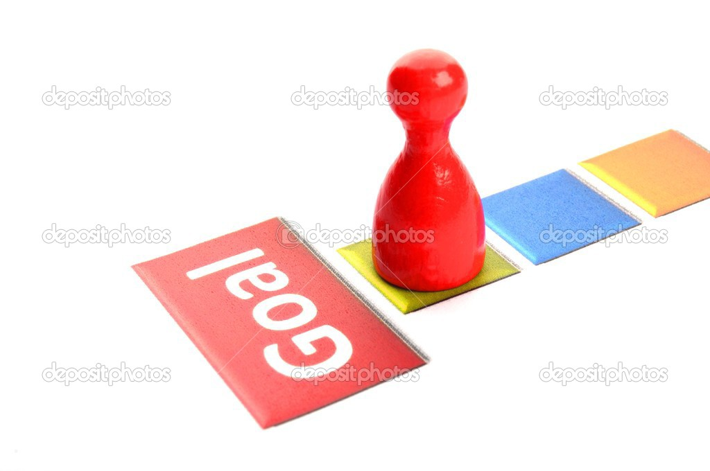 Business goal concept with word and game pawn — Stock Photo #4203088