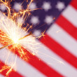 Stock Photo: Sparkler and usflag