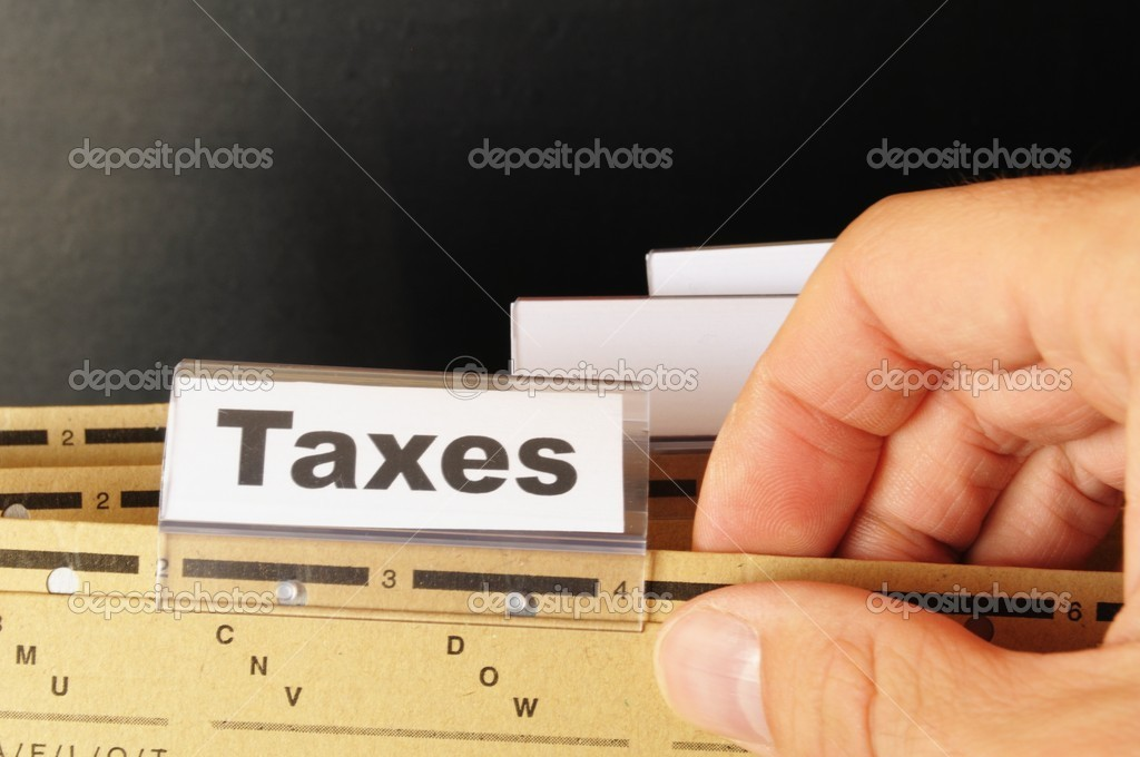 Tax or taxes concept with word on business folder index — Stock Photo #4354843