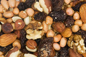 Background of mixed nuts and dried fruit — Stock Photo