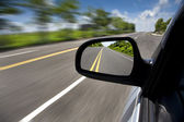 Car driving through the empty road — Stock Photo