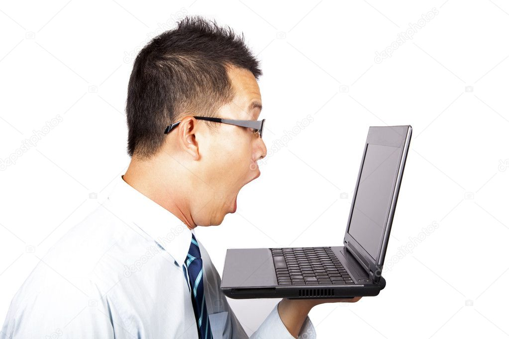 Surprised businessman with computer — Stock Photo #3521515
