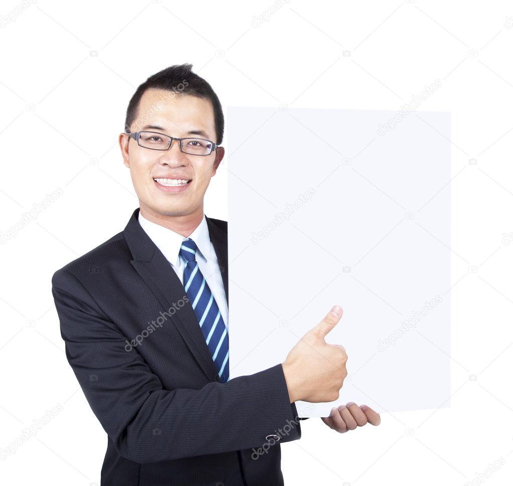 Young businessman holding empty board and thumb up  Stock Photo #3521558