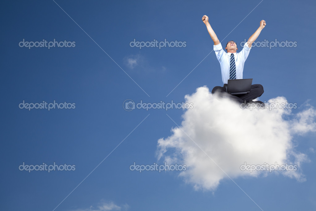 Young businessman with computer sitting on the cloud — Stockfoto #3521725