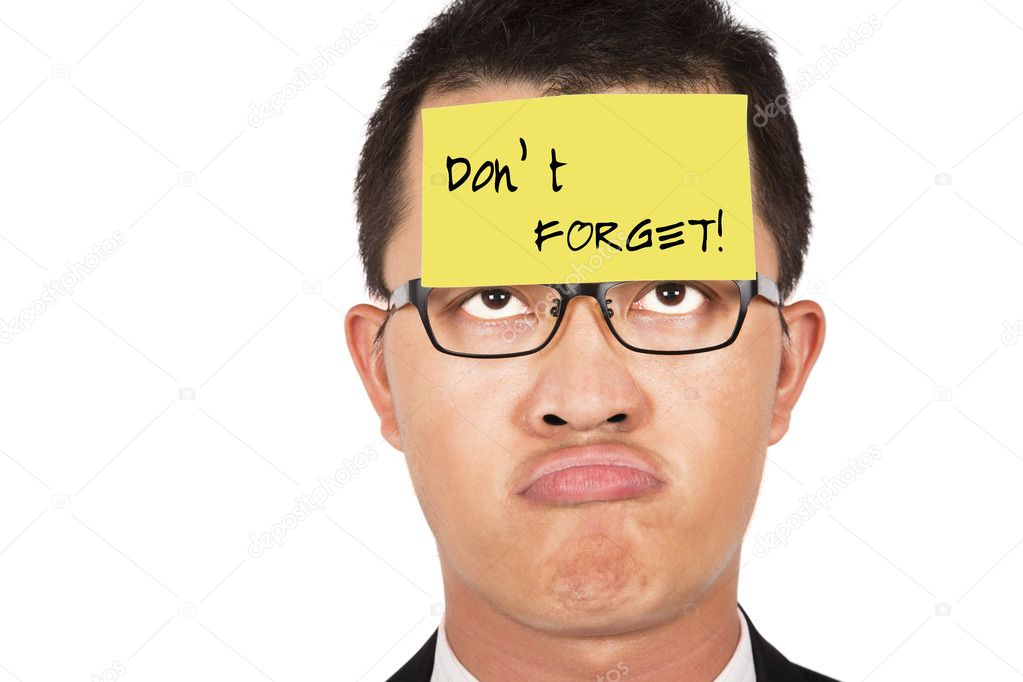 Do not forget and keep in mind.young businessman helpless looking the post it  — Stock Photo #3770079