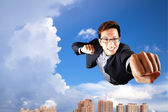 Businessman fly in the sky — Stock Photo