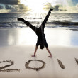 Happy new year 2011 on the beach of sunrise — Stock Photo #3840533