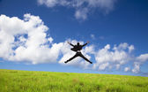 Happy and successful Businessman jumping — Stock Photo