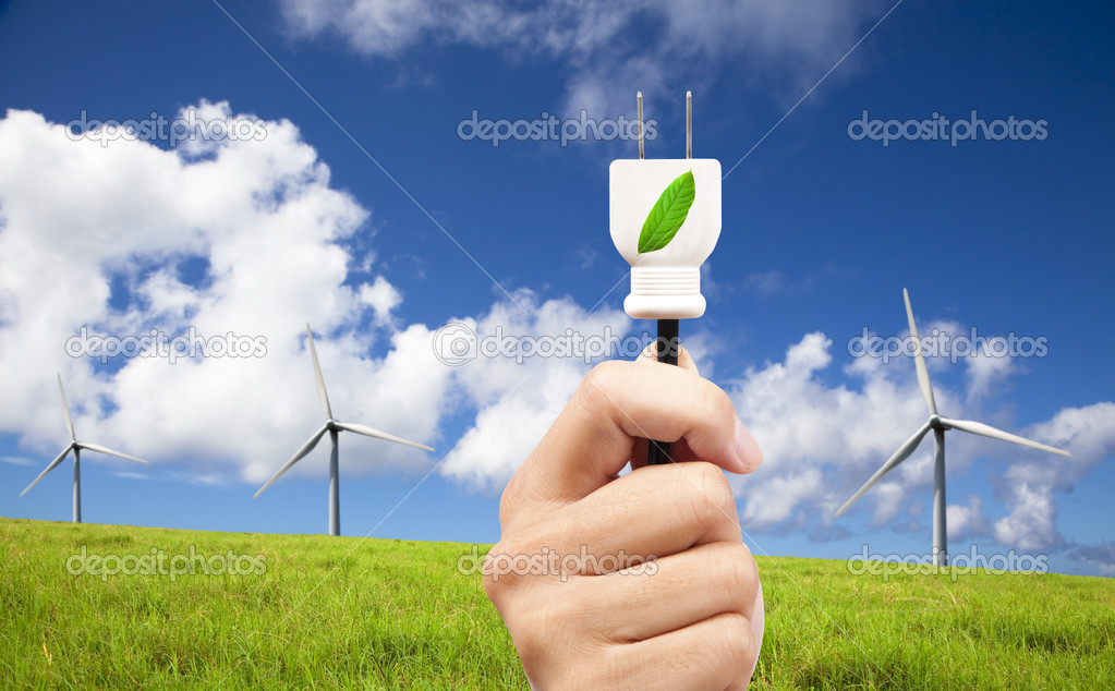 Hand hold eco power plug and Wind turbines on blue sky   Stock Photo #3880450