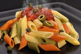 Steaming colourful penne — Stock Photo