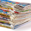 A pile of newspapers isolated - Stock Photo