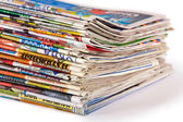 A pile of newspapers isolated — Stock Photo