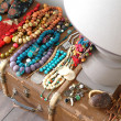 Lamp, beads and old suitcase on the floo - Foto de Stock