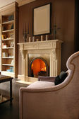 Fireplace in living room — Stock Photo