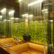 Interior of a bathroom with the grass — Stock Photo #3051622