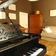 Interior of a living room with piano - Stock Photo
