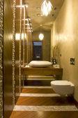 Modern toilet with big mirror — Stock Photo
