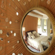 Mirror with beams and bedroom reflected — Stok fotoğraf