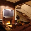 Stock Photo: Interior of living room with fireplace