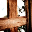 The window of the old wooden log house — Stock Photo
