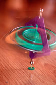 Whirligig is lying on a parquet — Stockfoto