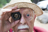 Person holding a vintage camera lens — Stock Photo