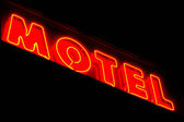 Motel sign lit up at night — Stock Photo