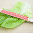 Lettuce with tape measure - Foto Stock