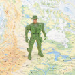 Toy soldier on world map - Foto Stock