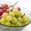 Source of glass with grapes — Stock Photo