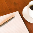 Notebook, pen and coffee cup — Stock Photo