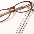 Notebook and glasses — Stockfoto #3032784