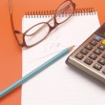 Calculator, glasses and pencil — Stock Photo